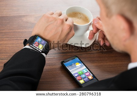 close up of smartwatch with application icons stock photo © dolgachov