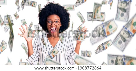 image of excited afro american woman wearing dollar glasses hold stock photo © deandrobot