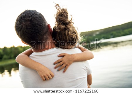 father and daughter solace on the pier warm summer day h Stock photo © Lopolo