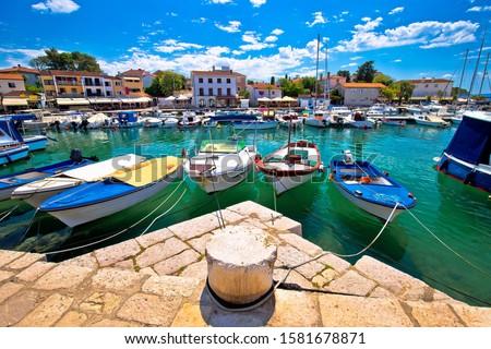 Krk. Town of Malinska harbor and waterfront view Stock photo © xbrchx