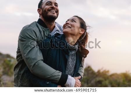 beautiful mixed couple in loving embrace stock photo © stryjek