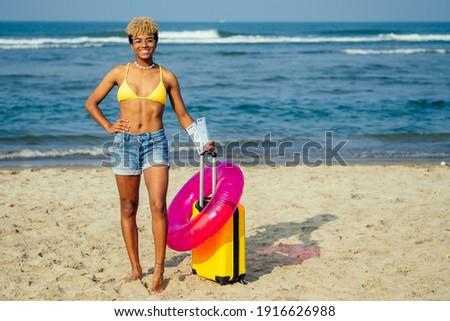 Güzel kız yüzme takım elbise bavul genç Stok fotoğraf © Aikon