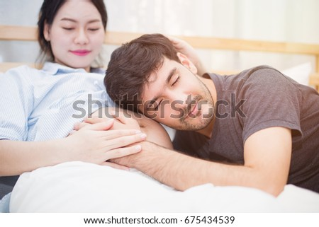 pregnant woman with her daughter on bedroom together ストックフォト © Lopolo