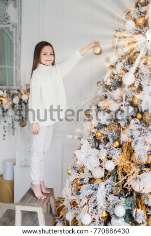 Vertical portrait of female child stands near New Year tree, hol Stock photo © vkstudio