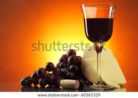 Stock photo: glass goblet and red beverage on the table