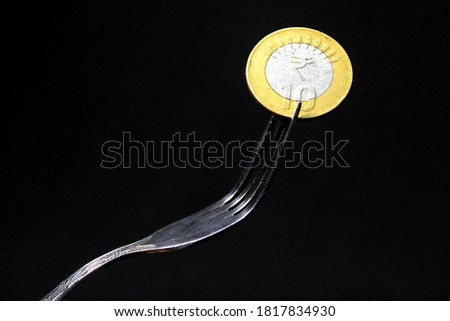spoon with coins on a black background stock photo © valeriy