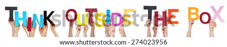 hands holding colorful word think outside the box stock photo © nelosa