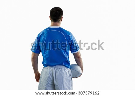 Back turned rugby player holding a ball stock photo © wavebreak_media