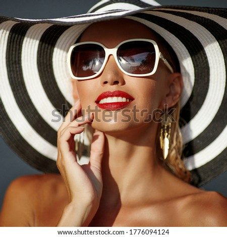 Face of attractive woman in golden makeup. Stock photo © NeonShot