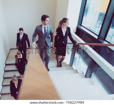 businessman and businesswoman walking and taking stairs in an of stock photo © boggy