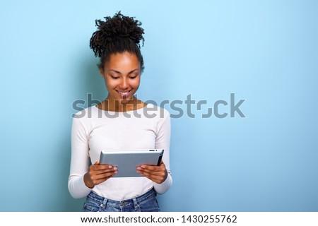 Nice black afro american on studio white background Stock photo © Lopolo