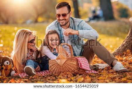 счастливая семья красивой осень парка женщину Сток-фото © Lopolo