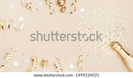 Or champagne bouteille confettis étoiles fête Photo stock © Illia