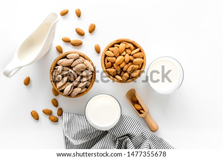 Bowl of almonds on a white background Stock photo © joannawnuk