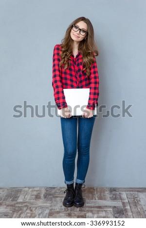 smiling red haired student girl in glasses Stock photo © dolgachov