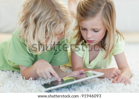 Siblings together on the floor using tablet Stock photo © wavebreak_media