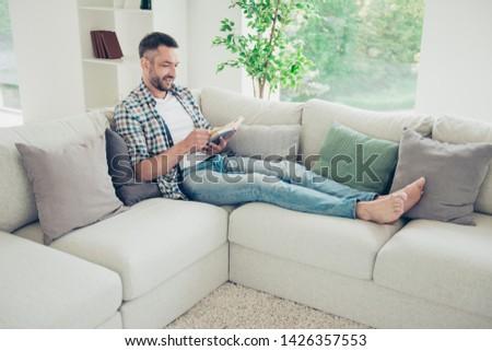 Nice Man sit on the sofa at home Сток-фото © Lopolo
