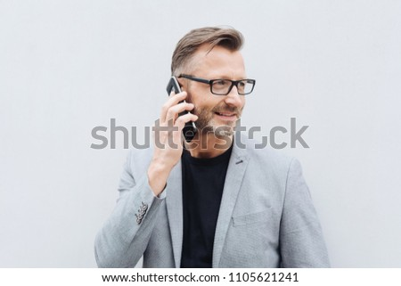 man with smartphone calling on city street Stock photo © dolgachov