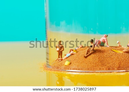 miniature people on the sand, in a bell jar Stock photo © nito
