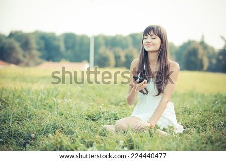 woman listening to music on smartphone at park stock photo © dolgachov