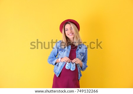 A beautiful pregnant woman on red background Stock photo © Lopolo