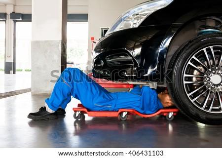 mechanic men repairing car at workshop Stock photo © dolgachov