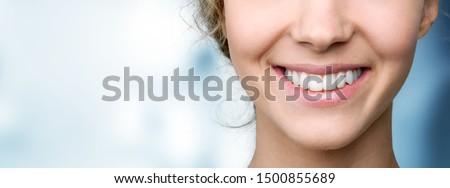 Sonriendo labios lápiz de labios primer plano nina Foto stock © Lighthunter