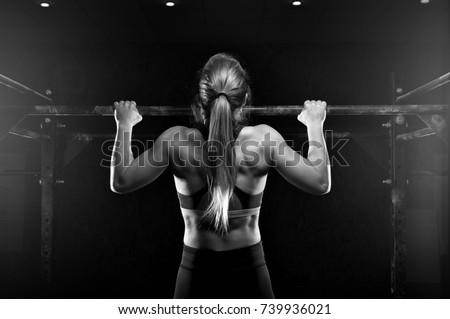 Pull ups Pull-up exercise workout girl at gym Stock photo © lunamarina