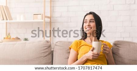 young woman enjoying her breakfast stock photo © giulio_fornasar