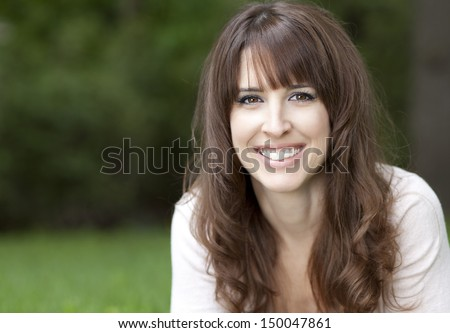 Close up beauty portrait of an excited brown haired woman Stock photo © deandrobot