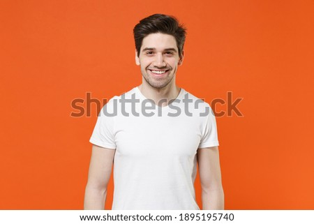 Portrait of unshaven young man posing and looking at camera Stock photo © deandrobot