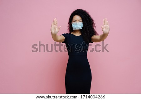 Image of serious African American woman pulls palms towards camera, make stop gesture, refusal sign, Stock photo © vkstudio
