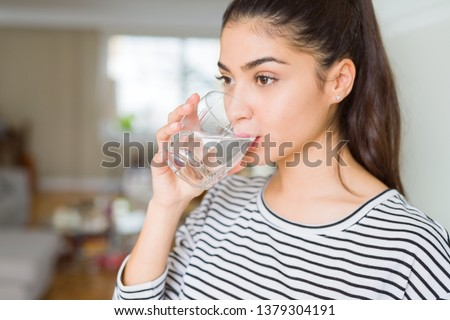 young woman drinking water stock photo © simply