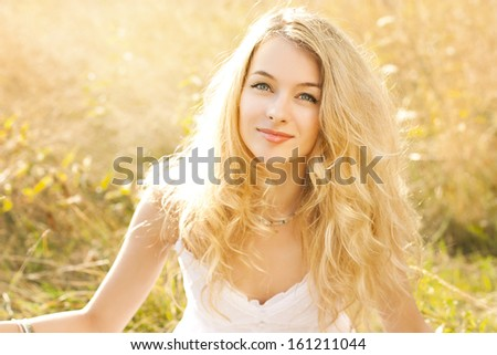Positive young woman in bright sunlight Stock photo © dashapetrenko