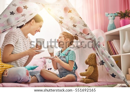 little girl playing tea party in kids tent at home Stock photo © dolgachov