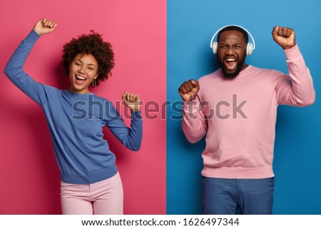 Cheerful woman dancing with arms up Stock photo © stockyimages