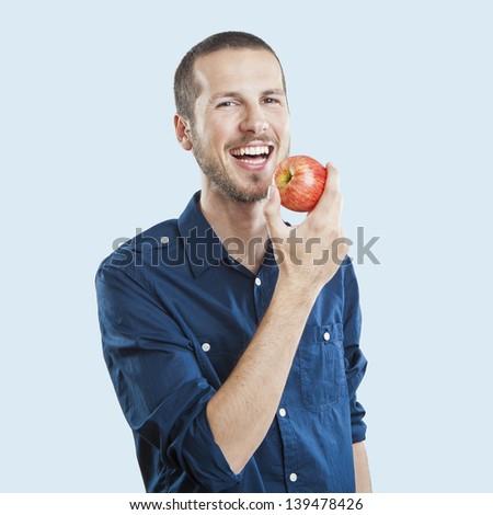 肖像 · 笑みを浮かべて · フィット · 若い男 · リンゴ · 立って - ストックフォト © wavebreak_media