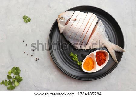 Fried pomfret fish and rice Stock photo © szefei