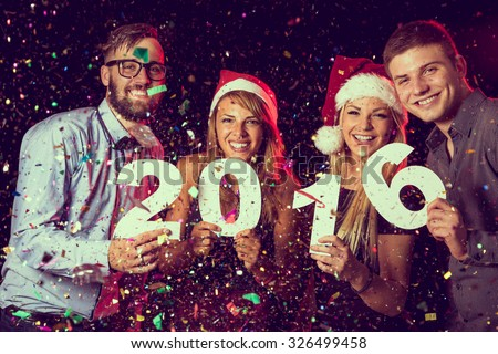 Happy couple in red hats celebrating New Year Stock photo © deandrobot