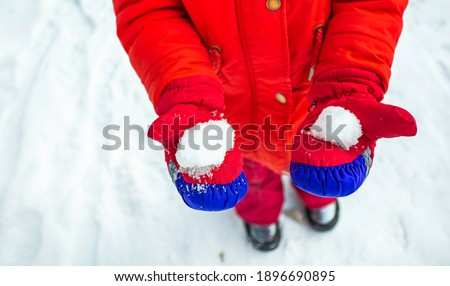 Woman Wearing Seasonal Red Mittens Holding Blue Christmas Orname Stock photo © feverpitch