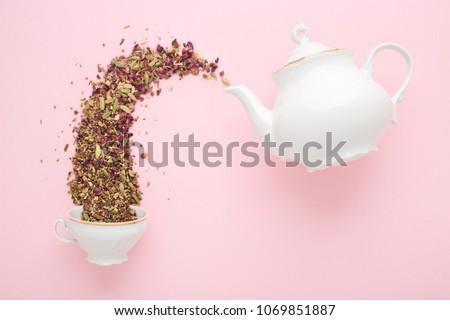 Teapot with dried flower petals Stock photo © dashapetrenko