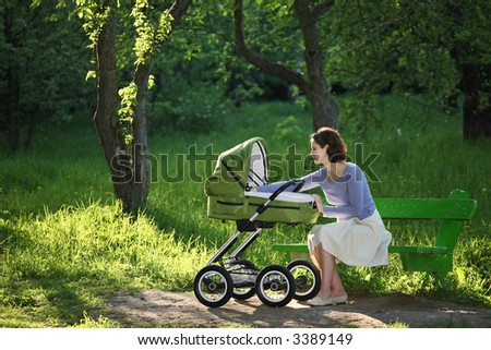 Young lady and pram Stock photo © balasoiu