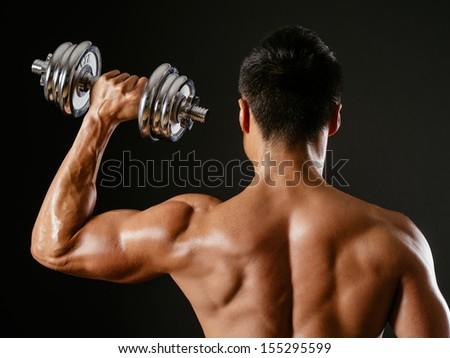 Asian male doing single shoulder press Stock photo © sumners