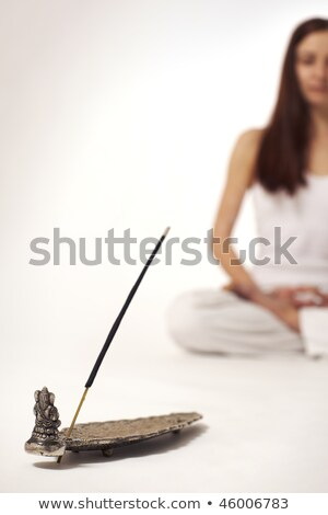 Incense stick with woman in lotus posture Stock photo © lichtmeister