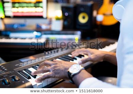 Mãos jovem músico teclas trabalhando sozinho Foto stock © pressmaster