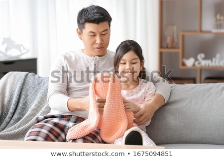 happy father and little daughter playing at home stock photo © dolgachov