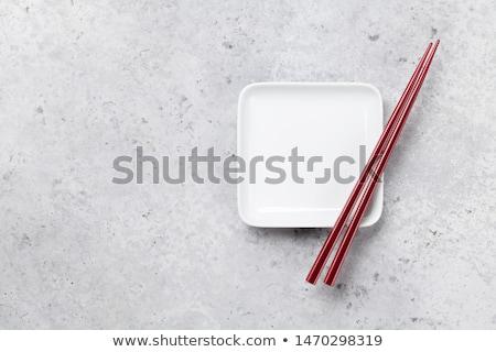 üres tányér evőpálcikák kő asztal japán étel Stock fotó © karandaev