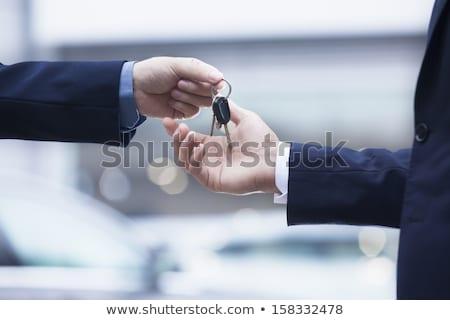 car salesman handing over the new car key stock photo © andreypopov