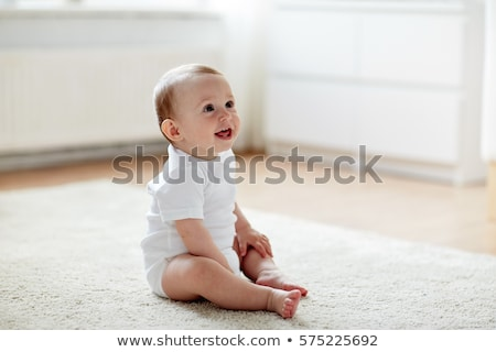 bébé · séance · étage · parents · souriant - photo stock © nyul