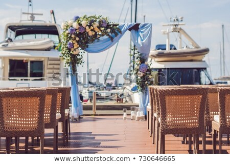 wedding set up in a yacht club against the background of yachts and the sea stock photo © galitskaya